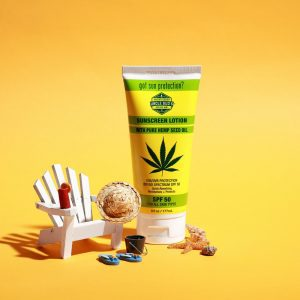One bottle of Uncle Bud's Hemp sunscreen lotion next to beach chair.