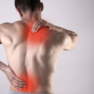 man with shoulder and back pain uncle buds Hemp Roll-On Pain Relief
