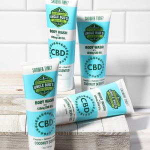 4 pack of uncle Bud's 120mg CBD body wash with tile background.