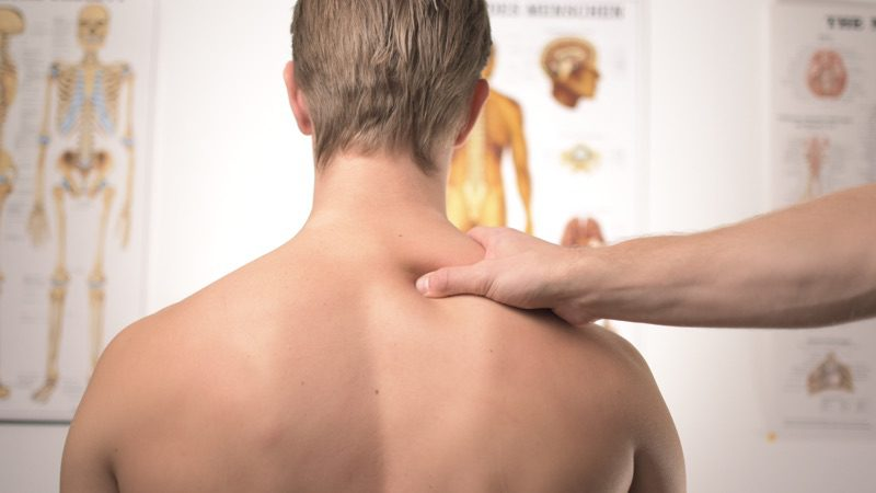 Man experiencing muscle soreness